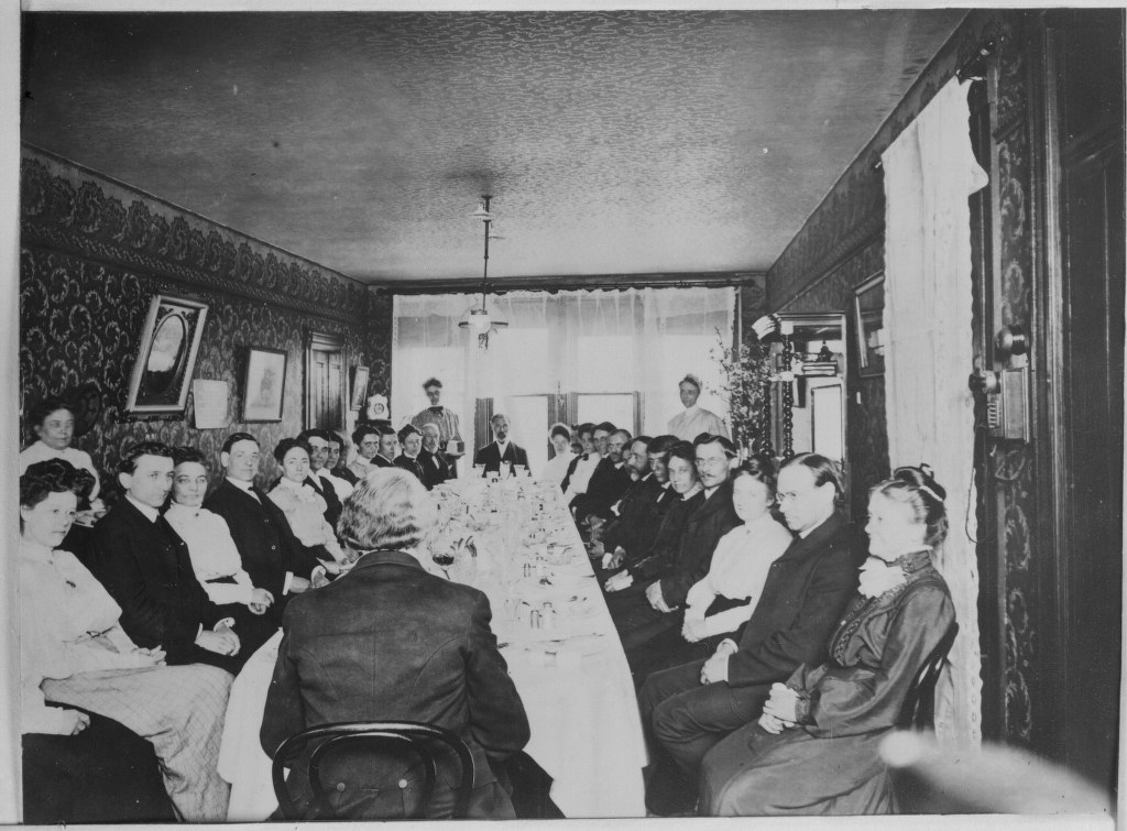 5b - 1909 Or Earlier - Bible House Family Around Dining Room Table 1024x755