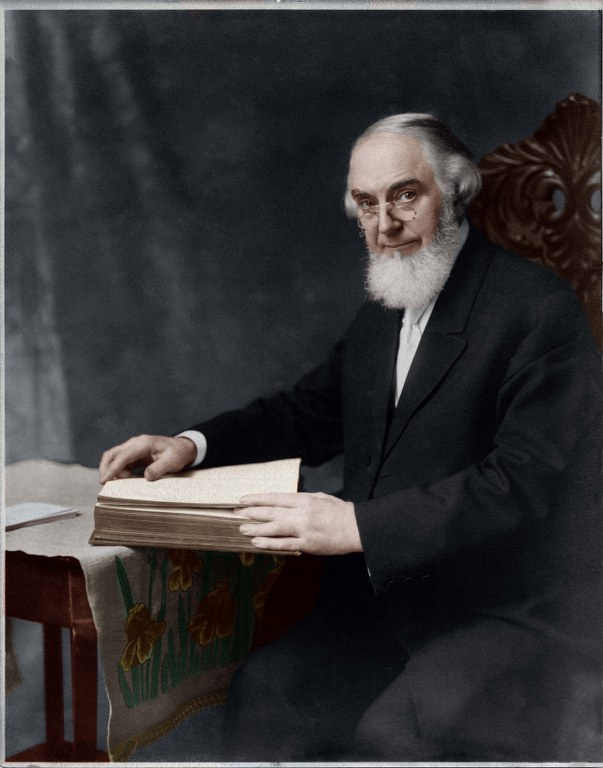 P21 - Pastor Russell - 1911 - Looking Up From Bible - Retouched - Colorized 603x768